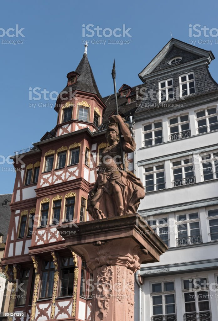the minervabrunnen in front of the half-timbered houses on Roemerberg in Frankfurt, Germany royalty-free stock photo
