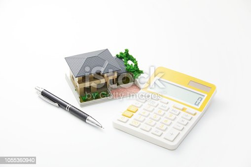 the miniature of the house and calculator