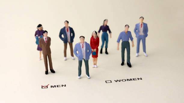 The miniature people standing in front of a check box selected as a MEN. The concept of the discriminatory rate between men and women in employment. The miniature people standing in front of a check box selected as a MEN. The concept of the discriminatory rate between men and women in employment. discriminatory stock pictures, royalty-free photos & images