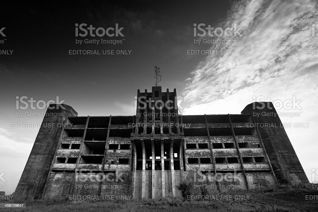 The Ministry Monrovia, Liberia - February 24, 2012: The abandoned Ministry of Defence building stands empty and ruined, a reminder of the civil war here not so long ago. Africa Stock Photo