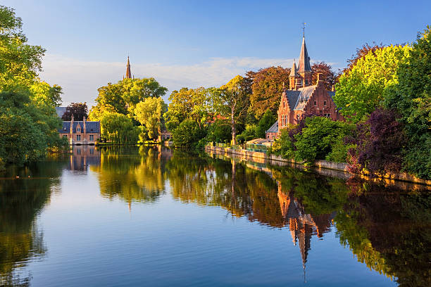 The Minnewater of Bruges, Belgium The Minnewater (or Lake of Love), a fairytale scene in historic Bruges belgium stock pictures, royalty-free photos & images