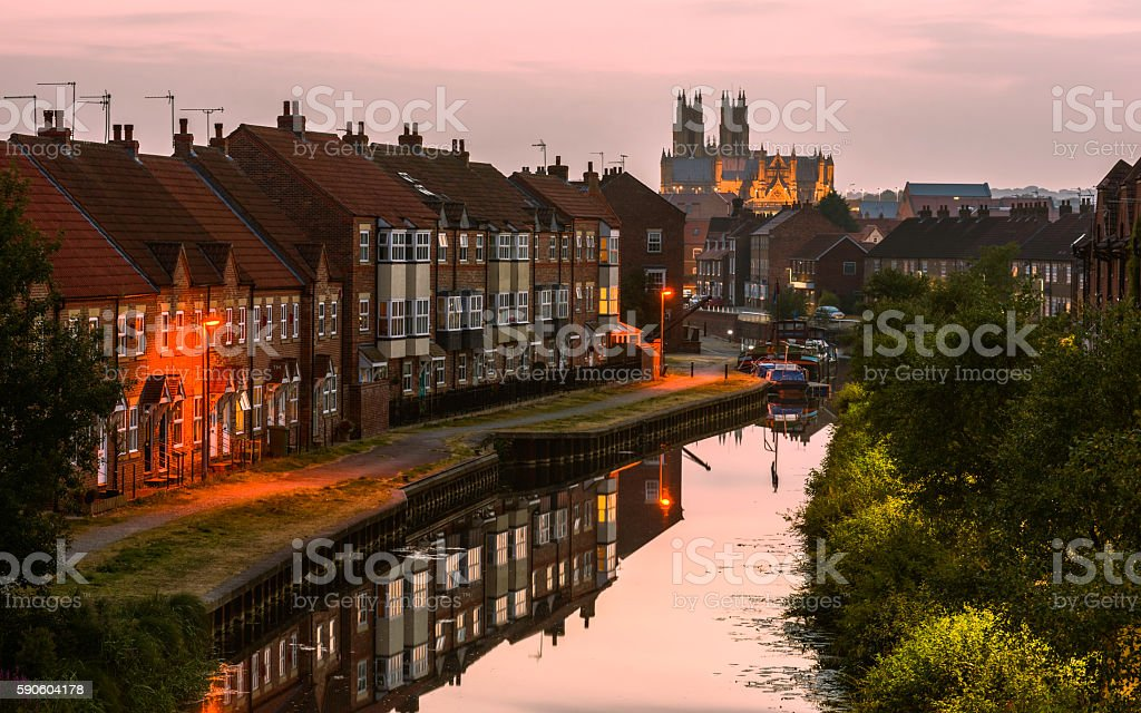 The Minster, beck, and townhouses at sunset, Beverley, Yorkshire, UK. stock photo