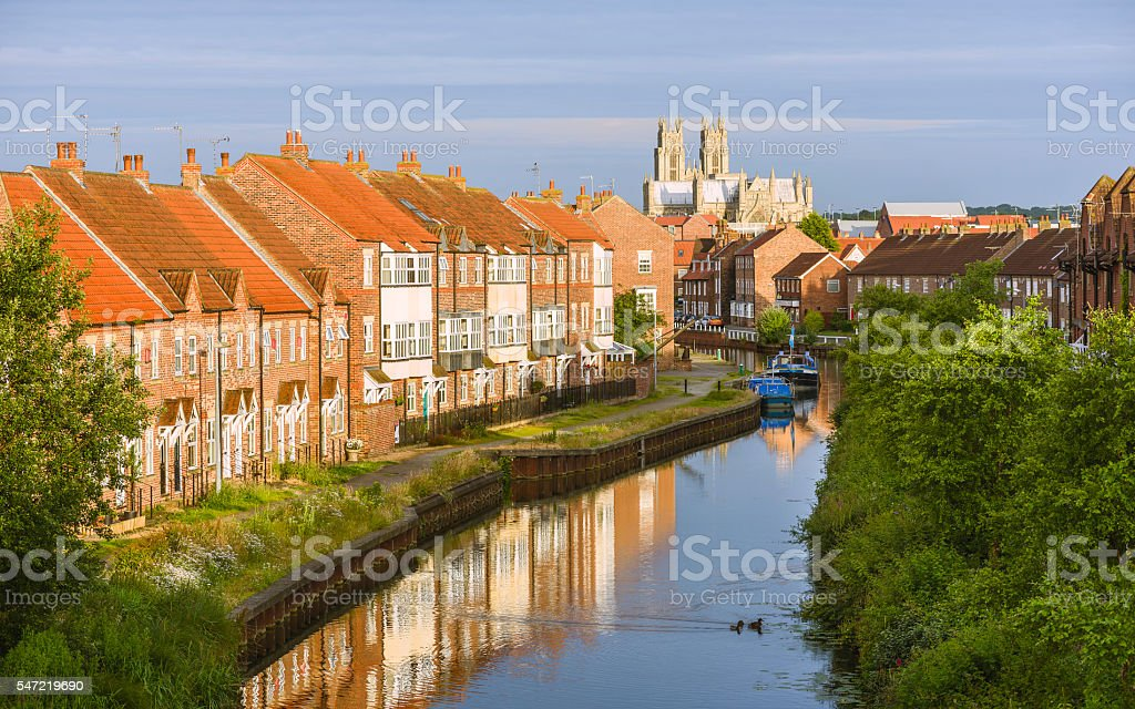 The minster, town houses, and the beck, Beverley, Yorkshire, UK. stock photo