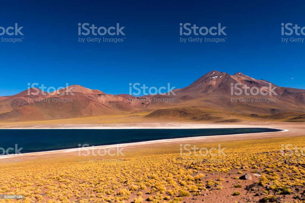 The Miscanti Lake (Laguna Miscanti) with the surrounding mountains and volcano in the Atacama Desert, Chile stock photo