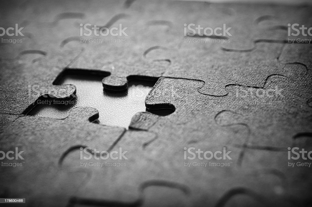 The missing black puzzle close up stock photo