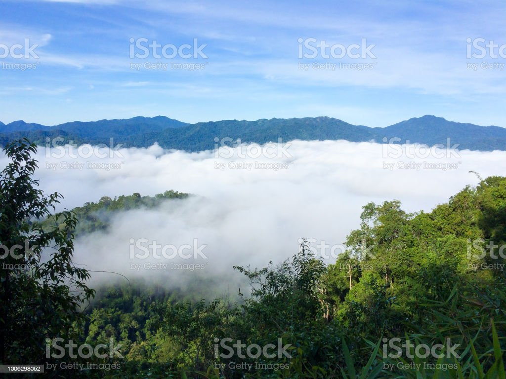 The mist sea with mountain backgorund at Phanoen Thung Camp, Phetchaburi Province Thailand. stock photo
