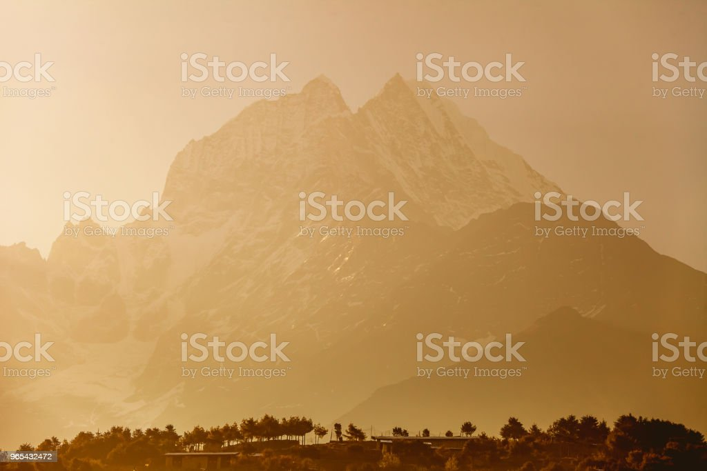 The misty Thamserku Mountain. The Himalayas royalty-free stock photo