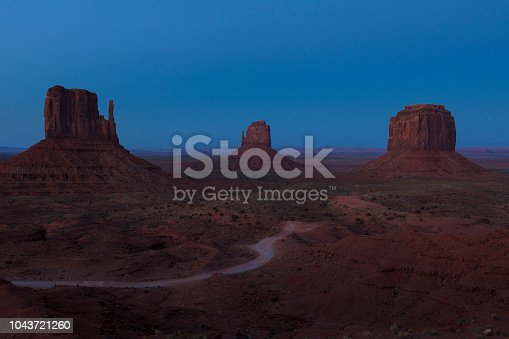 The East and West Mittens in the majestic landscape of Monument Valley Navajo Tribal Park at sunrise in Arizona, USA.