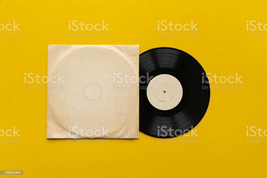 the mockup template with the new vinyl disc on color surface, music album cover design the mockup template with the new vinyl disc on color surface, music album cover design Analog Stock Photo