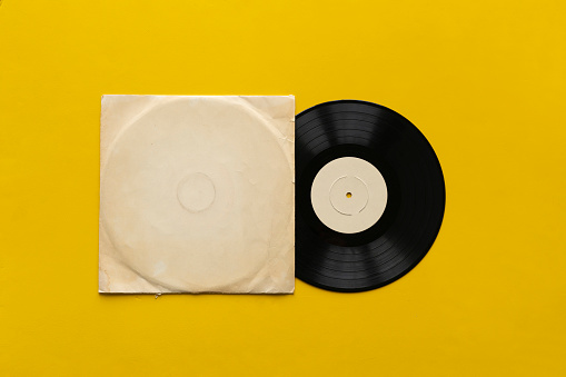 The Mockup Template With The New Vinyl Disc On Color Surface Music Album Cover Design Stock Photo - Download Image Now