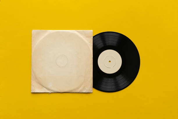 the mockup template with the new vinyl disc on color surface, music album cover design stock photo