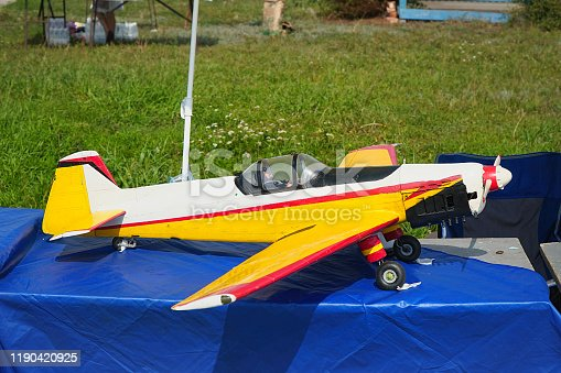 The model airplane is handcrafted with a propeller on radio control