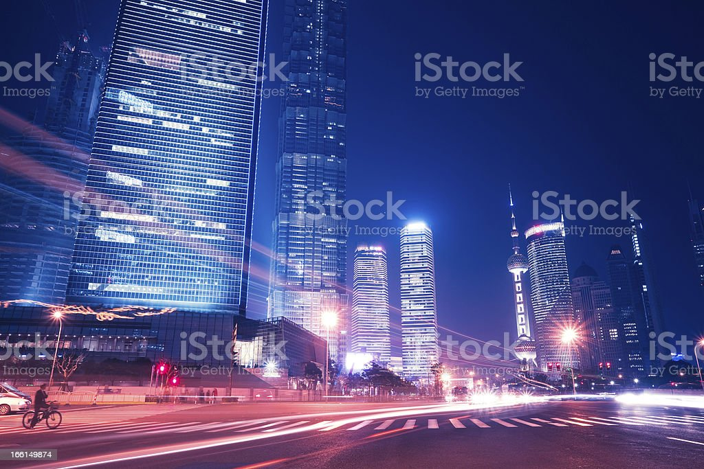 The modern city brilliantly illuminated at night royalty-free stock photo