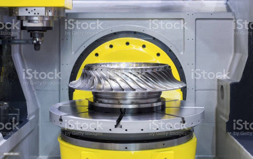 The modern CNC machining center processes the turbine wheel stock photo