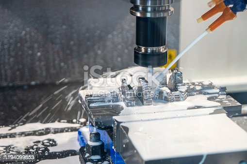 istock The mold and die manufacturing process with machining center by liquid coolant method. 1194099853