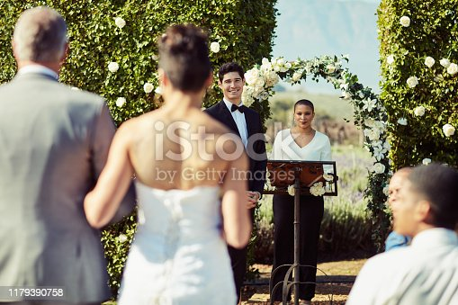 Shot of a mature man walking his daughter down the aisle while her groom waits at the wedding altar