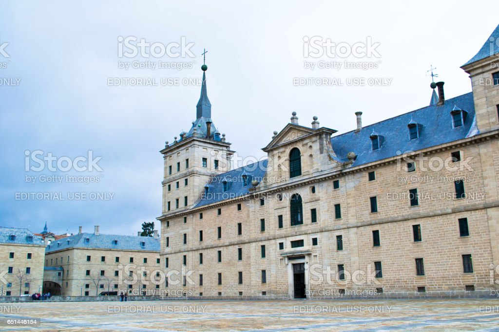 ESCORIAL, SPAIN - FEBRUARY 21, 2013: The monastery Escorial — the monastery, the palace and the residence of the king of Spain Philip II. It is located in an hour of driving from Madrid at the foot of mountains of Sierra-de-Gvadarrama. stock photo