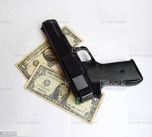 The money and the gun.
