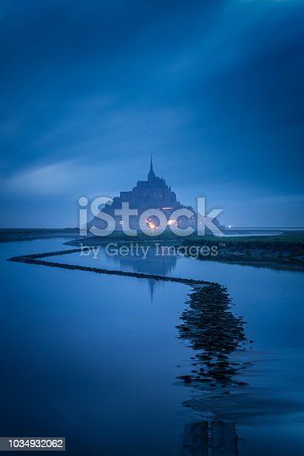 The Mont Saint Michel and its bay during the blue hour. Normandy, France