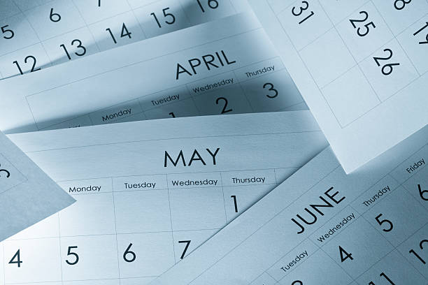 The months and days of the year on calendar paper Calendars month stock pictures, royalty-free photos & images