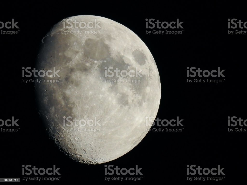 The Moon in the clear night sky. stock photo