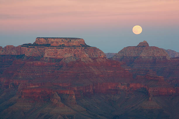 The moon rising above the Grand Canyon stock photo
