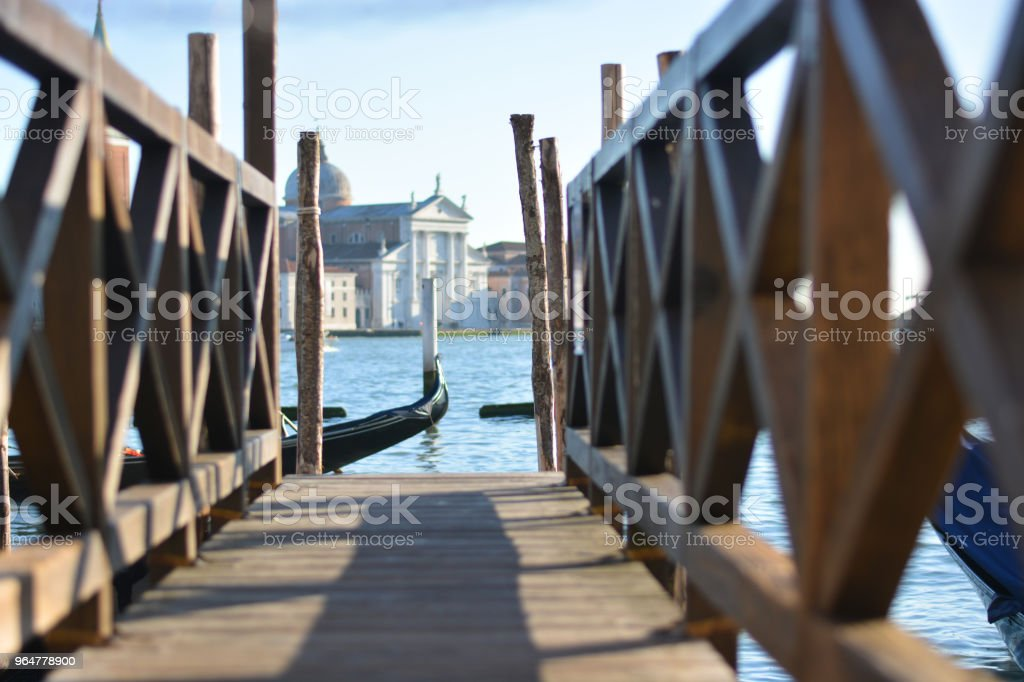 The mooring in Piazza San Marco on the Venice lagoon and in the background the island of San Giorgio royalty-free stock photo