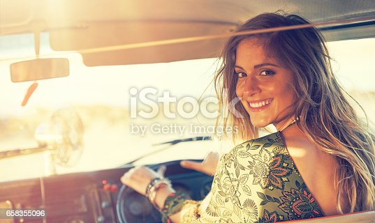Shot of a gorgeous young woman enjoying a roadtrip on her own