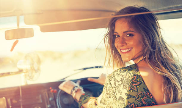 The more the miles the more the smiles Shot of a gorgeous young woman enjoying a roadtrip on her own romani people stock pictures, royalty-free photos & images