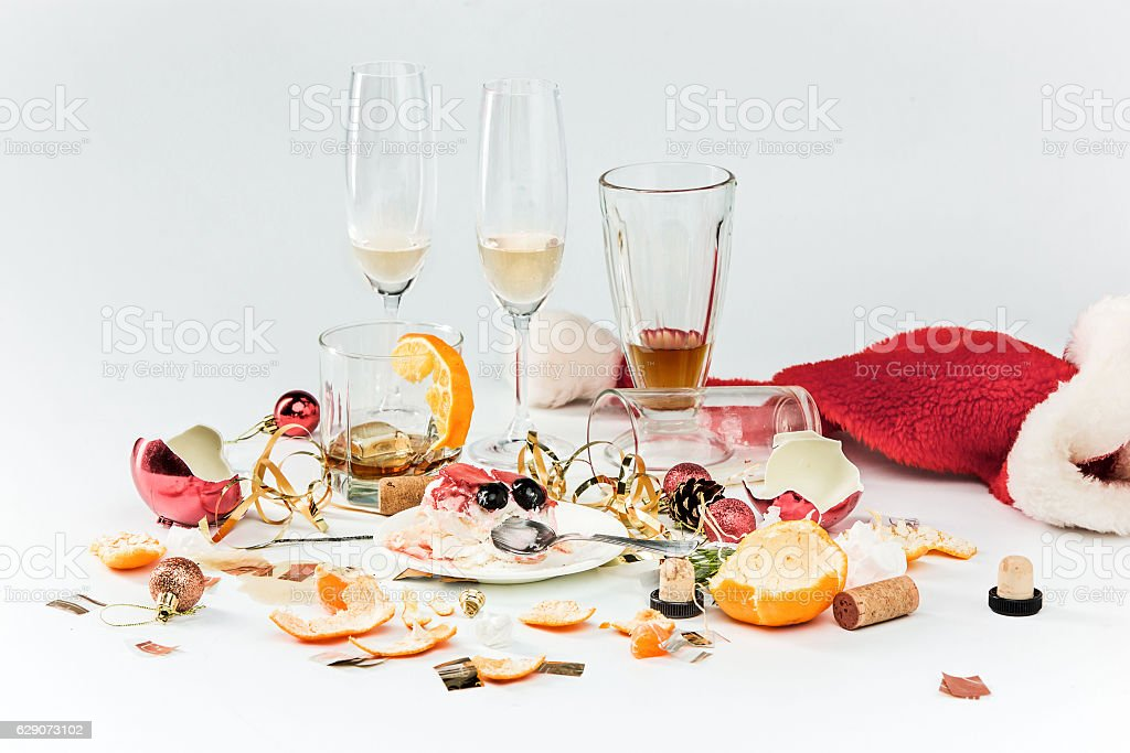 The morning after christmas day, table with alcohol and leftovers photo libre de droits