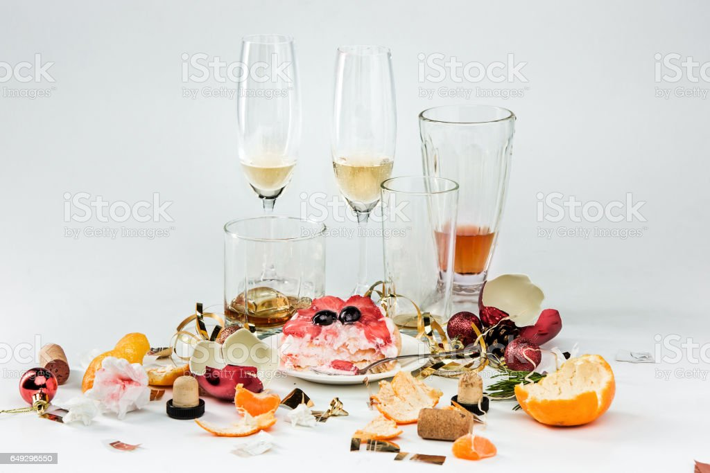 The morning after christmas day, table with alcohol and leftovers stock photo