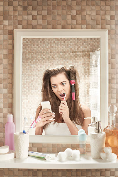 the morning after - cell phone toilet stockfoto's en -beelden