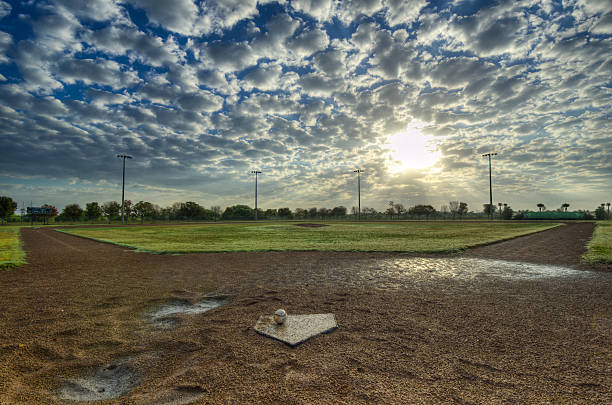 The Morning Game Baseball diamond in the early morning light, creating a dramatic feeling from HDR. baseball diamond stock pictures, royalty-free photos & images