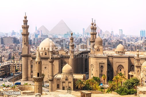 istock The Mosque-Madrassa of Sultan Hassan and the Pyramids in the background, Cairo, Egypt 1147133003