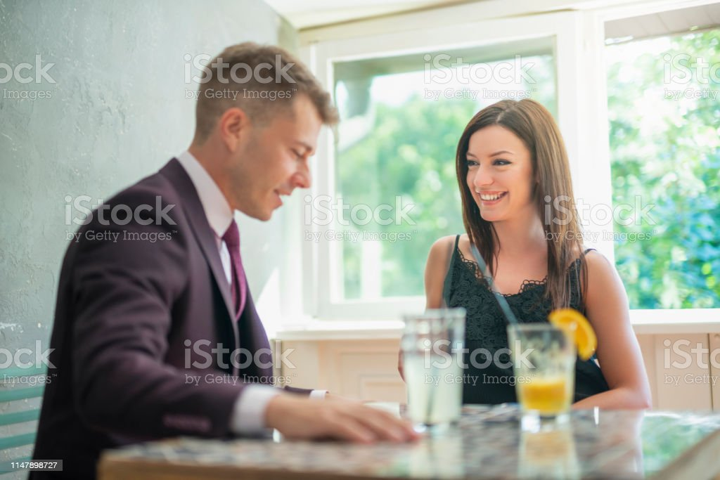 Young attractive and beautiful woman on a romantic date with handsome...
