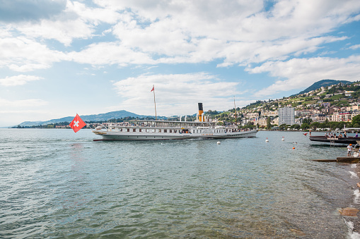 The most beautiful  steam boat called La Suisse approaching Montreux pier on Swiss Riviera, Vaud, Switzerland on summer day