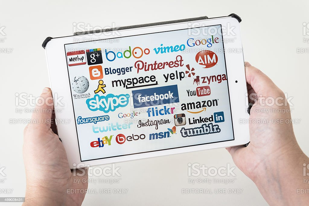 The most famous social media website on new Ipad mini royalty-free stock photo