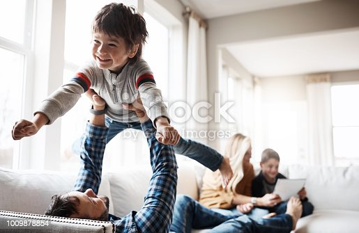 Shot of a happy family having fun together at home