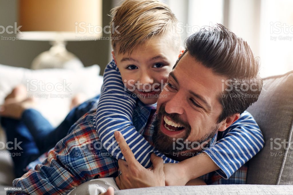 The most important thing for a kid's success is their happiness - Royalty-free Adult Stock Photo