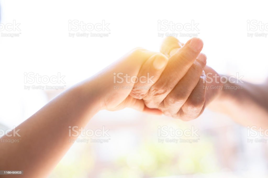 The mother is holding the hand of the child. Mother\'s and child...