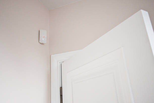 The motion sensor was triggered when the door was open, the home alarm system The motion sensor was triggered when the door was open, the home alarm system sensor stock pictures, royalty-free photos & images