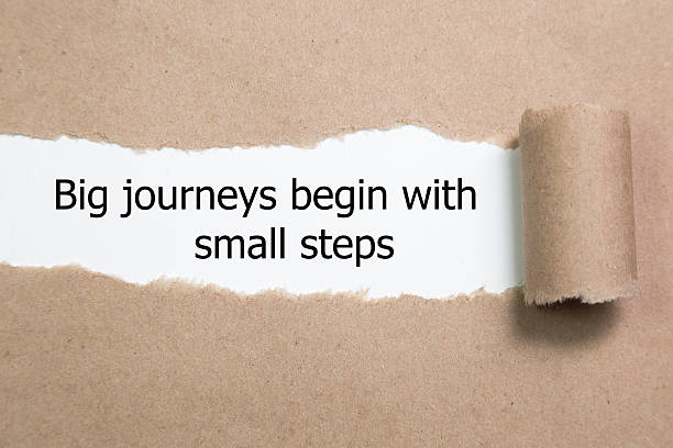 The motivational quote Big journeys begin with small steps stock photo