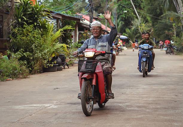 The motorbike folks stock photo
