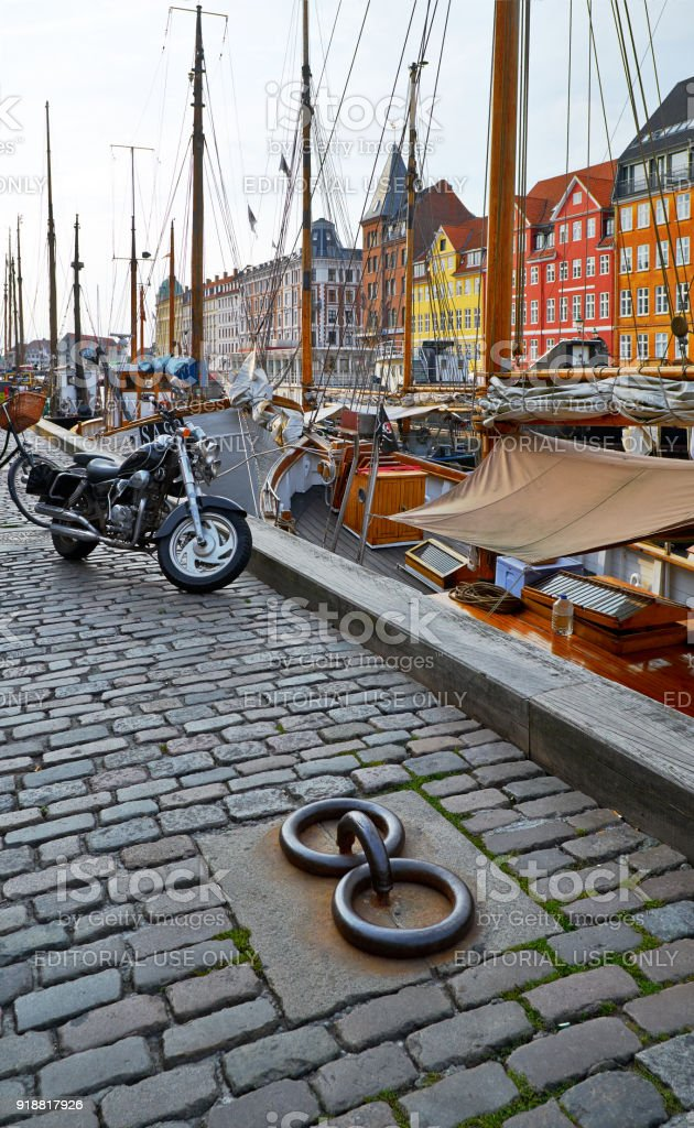 The motorcycle on the Nyhavn paving stone pavement in Copenhagen. stock photo