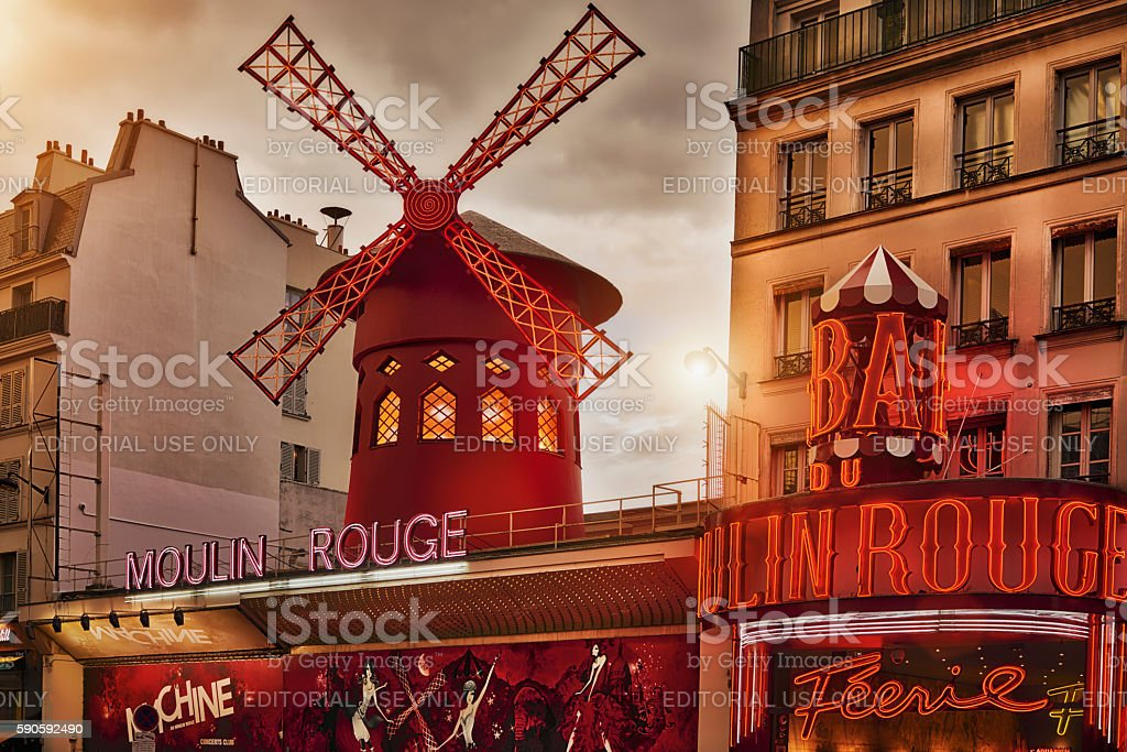 The Moulin Rouge by night, in Paris stock photo