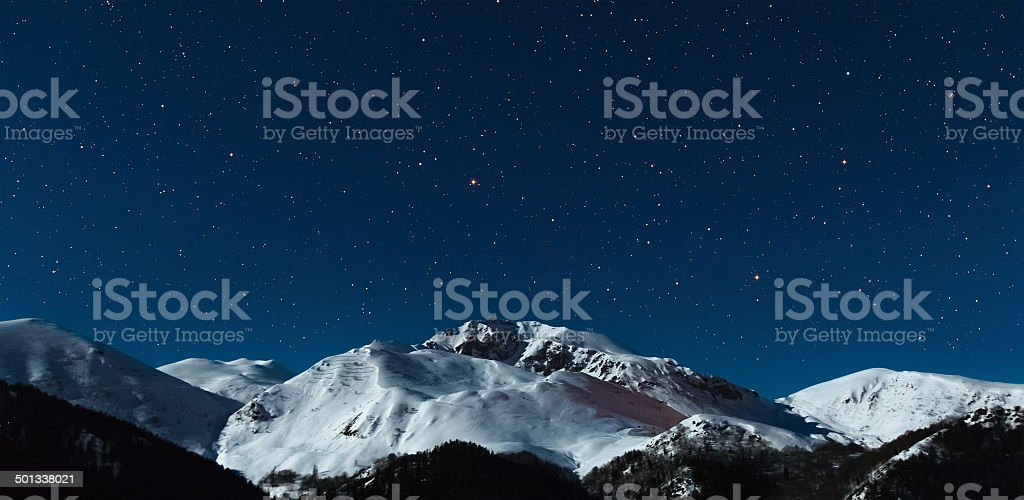 the mountain in moonlight and stars sky stock photo