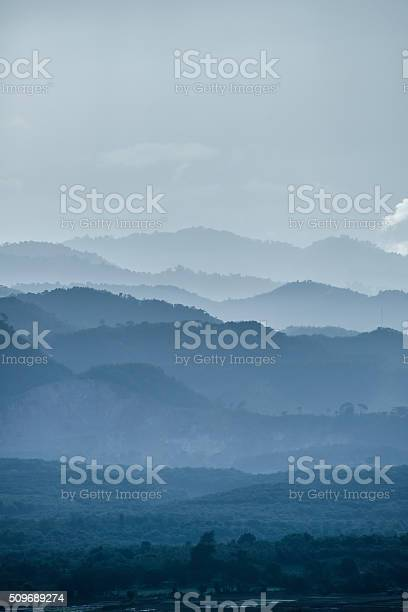 Photo of The mountains layer in the mist.