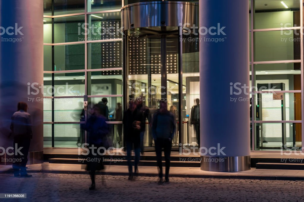 The movement of people at the entrance to modern building