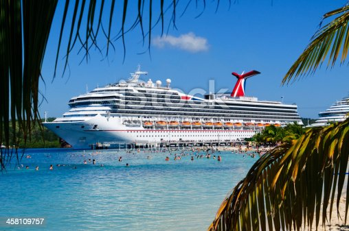 Roatan, Honduras - March 23, 2011: The M.S. Carnival Valor, owned by Carnival Cruise Lines, docked at Mahogany Bay on the Caribbean island of Roatan.