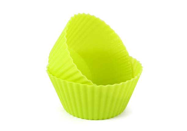 The muffin cups The muffin cups on white background muffin tin stock pictures, royalty-free photos & images
